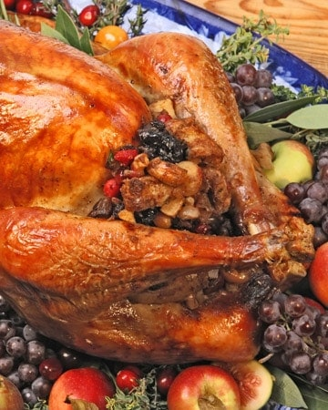 roast turkey dinner with fruit and nut stuffing that includes prunes, apricots, raisins, currants, apples, cranberries, walnuts, macadamia nuts, and cashews