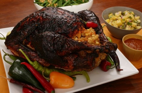 Mole roasted turkey with masa stuffing and chile gravy