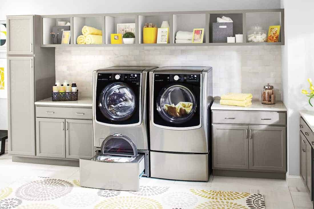sleek LG appliances in a grey and yellow laundry room How To Remove Common Laundry Stains