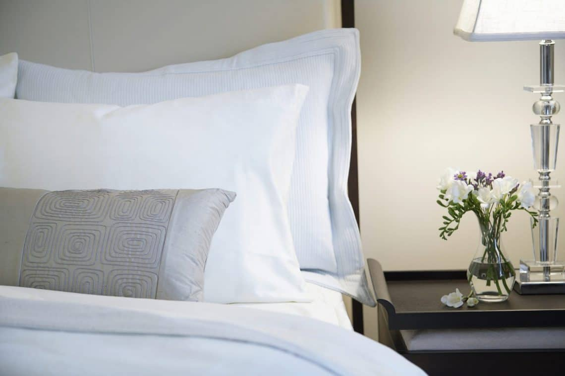 hotel bed and nightstand