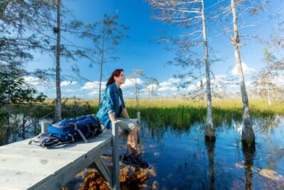 Woman Sitting on Dock in the Everglades scaled