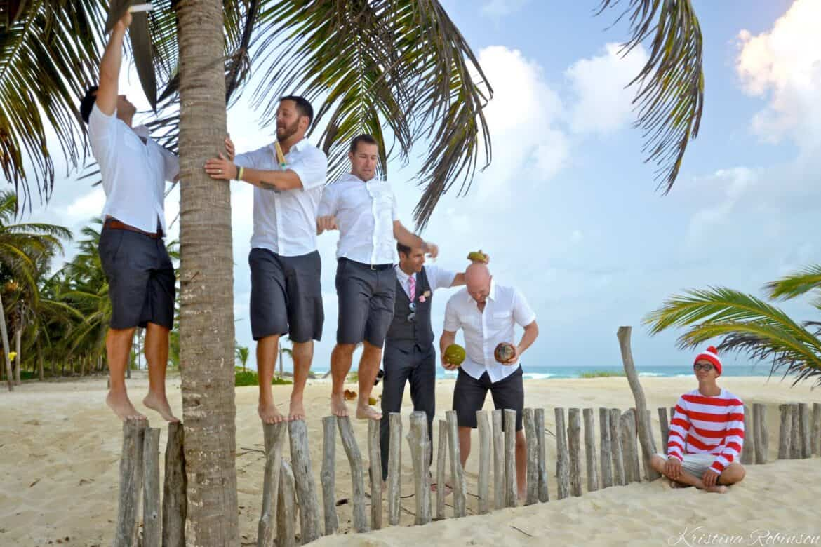 fun bridal party photo groomsmen playing with coconuts