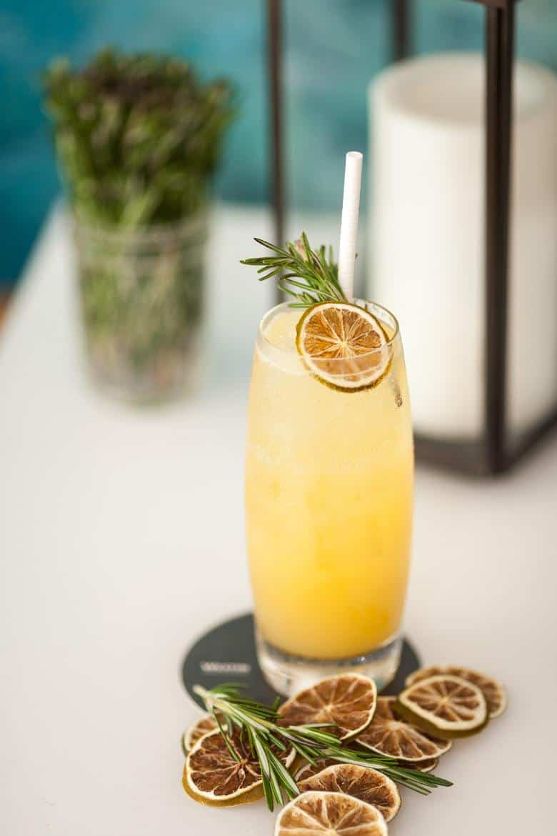 passion fruit cocktail with rosemary